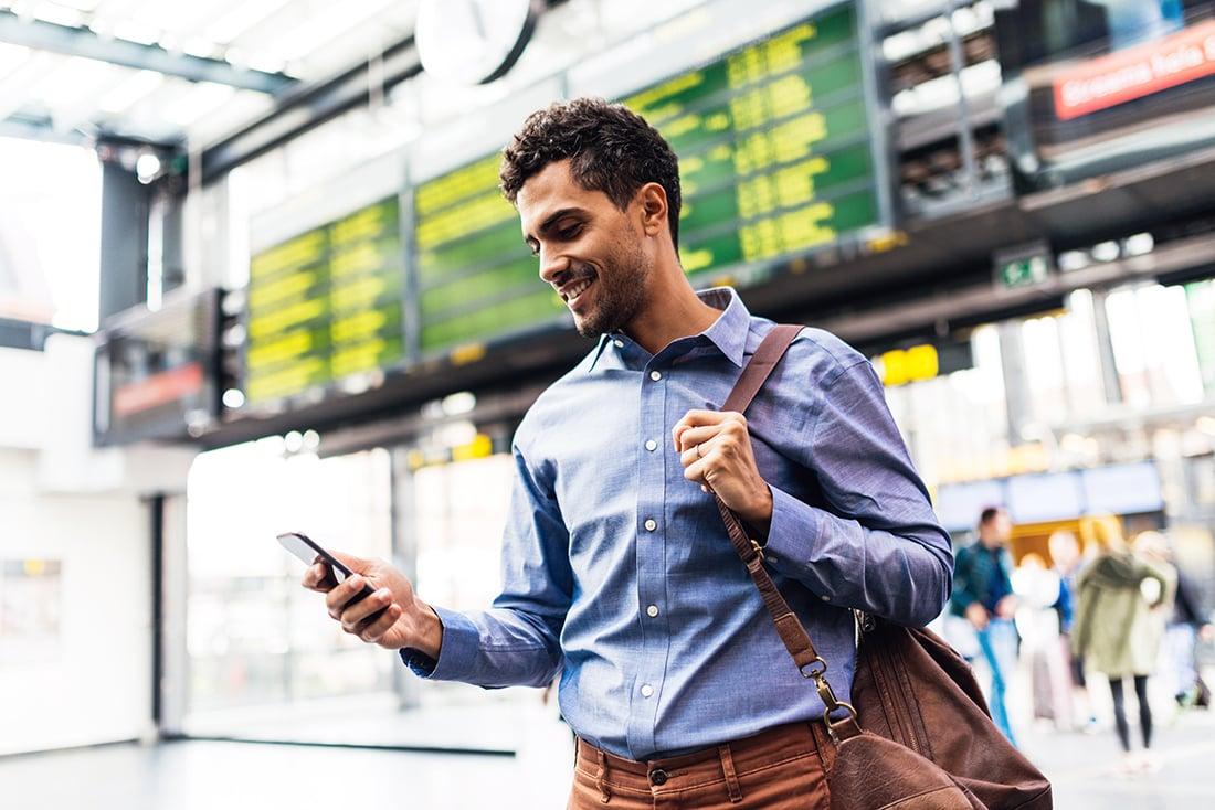 happy-guy-checking-total-rewards-phone